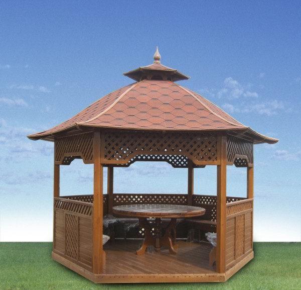 Убранство садового домика в китайском стиле состоит из скамеек и столика